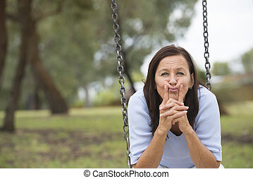 Concerned worried mature woman outdoor