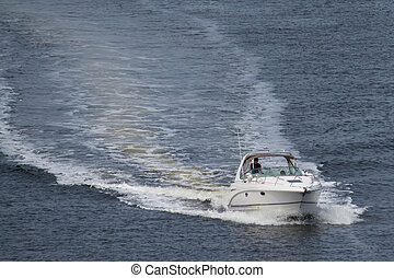 Boating - A speed boat cruising down the waterway