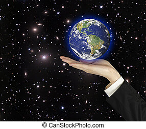Planet earth on palm.Elements of this image furnished by NASA