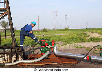 oilfield with worker and pipeline
