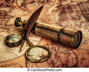 Vintage items on ancient map. - Vintage magnifying glass,...