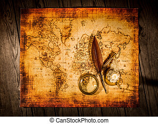 Vintage items on ancient map. - Vintage quill pen and...