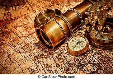 Vintage items on ancient map. - Vintage compass, , spyglass...