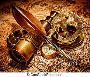Vintage items on ancient map - Vintage compass, goose quill...