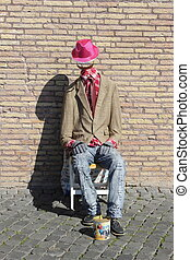 Dummy poor ask for charity - manikin with an actor street...