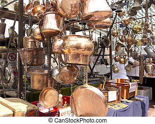 Selling old copper cookware. San Telmo market in Buenos...