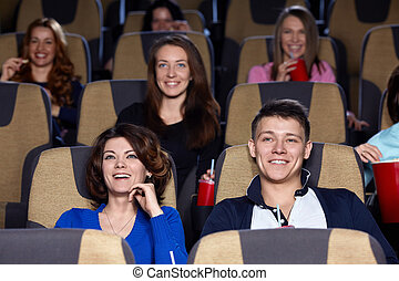 Spectators - Smiling people in cinema