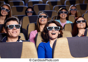 At the cinema - Young people in 3D glasses in cinema