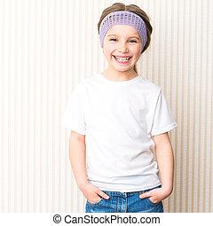 ittle girl in white t-shirt - Cute smiling little girl in...