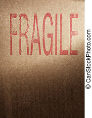 Fragile - Closeup of a brown cardboard box with word...