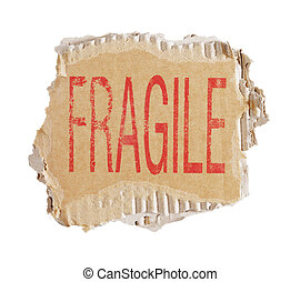 Fragile - Word Fragile stamped on a piece of brown...
