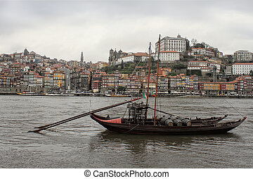 Porto boats and buildings - View of Porto and bridge along...