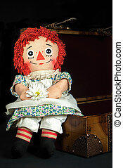 retro rag doll - Old rag doll with daisy sitting on a...