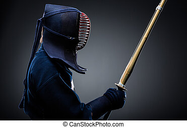 Profile of kendoka with bokuto - Profile of kendo fighter...