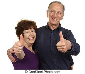 Happy couple - An elderly couple showing a thumbs up sign,...