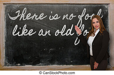 Teacher showing There is no fool like an old fool on...