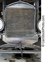 Antique Car Front View - Front view of an antique vintage...