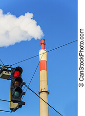 industrial chimney and red light - chimney of an industrial...