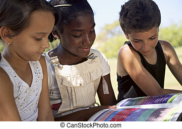 Children and education, kids and girls reading book in park...
