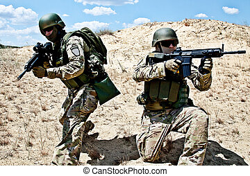 military operation - Two soldiers in the desert during the...