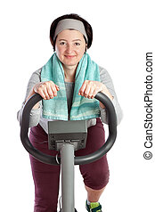 Fat woman loses weight herding fat on a stationary bike. On a white background.
