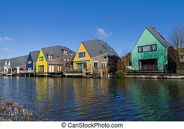 colorful houses at the island district, Almere, the youngest...