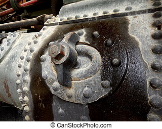 Oil leaking from the boiler of a vintage steam engine