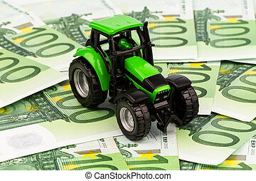 tractor on euro banknotes - a tractor standing on euro...