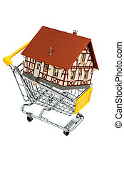 buy a house - half-timbered house in the shopping cart icon...