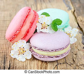 Macaroons - French macaroons .Almond cookies on wooden...