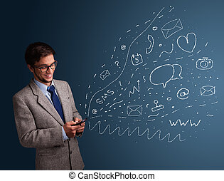 Boy typing on smartphone with various modern technology icons