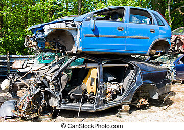 junk cars in a junkyard - many junk cars in a junkyard...