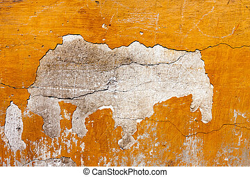 Badly damaged red plaster wall background