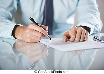 Business contract - Businessman is signing a contract,...