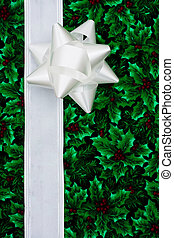 Holiday Border - White ribbon and bow on leaf and holly...