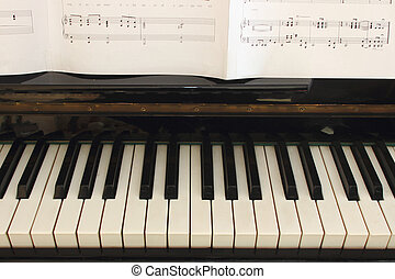 Piano keyboard and score - Portion of piano keyboard and...