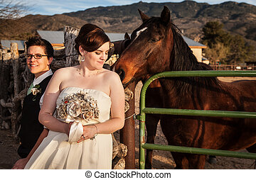 Lesbian Bride with Partner and Horse - Lesbian bride with...