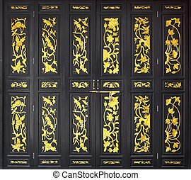 flower carved gold paint on wood door