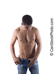 Portrait of sexy young man in jeans