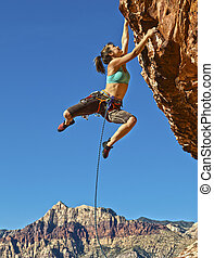 Female rock climber. - Female rock climber dangles from the...