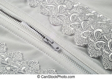 white zipper - picture of a zipper in a white and laced...