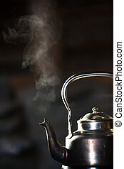 Boiling kettle - Silver Vintage Boiling kettle on a wood...