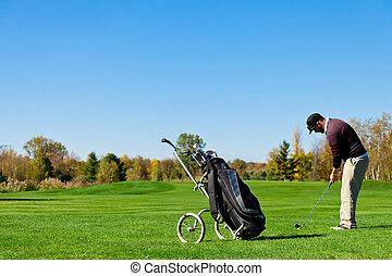 Man playing golf on a beautiful day