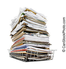 pile of files in tray - office in tray piled high with a...