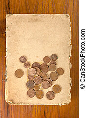 Copper eurocents coins on old book