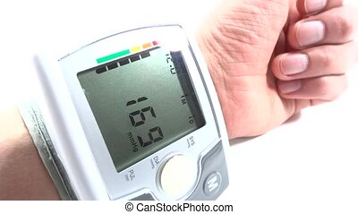 hand with tonometer - hand with cardiac devices