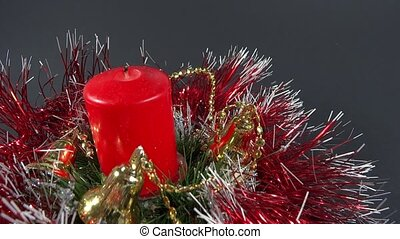 person lighting the candle on holiday ornament