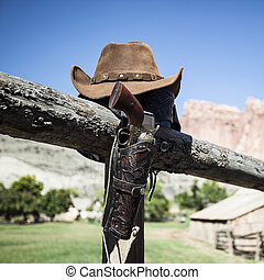 cowboy gun and hat outdoor under sunlight, USA
