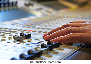 Mixing Board - Professional audio mixing console with faders...