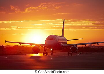 Runway - Airplane at sunset - back lit